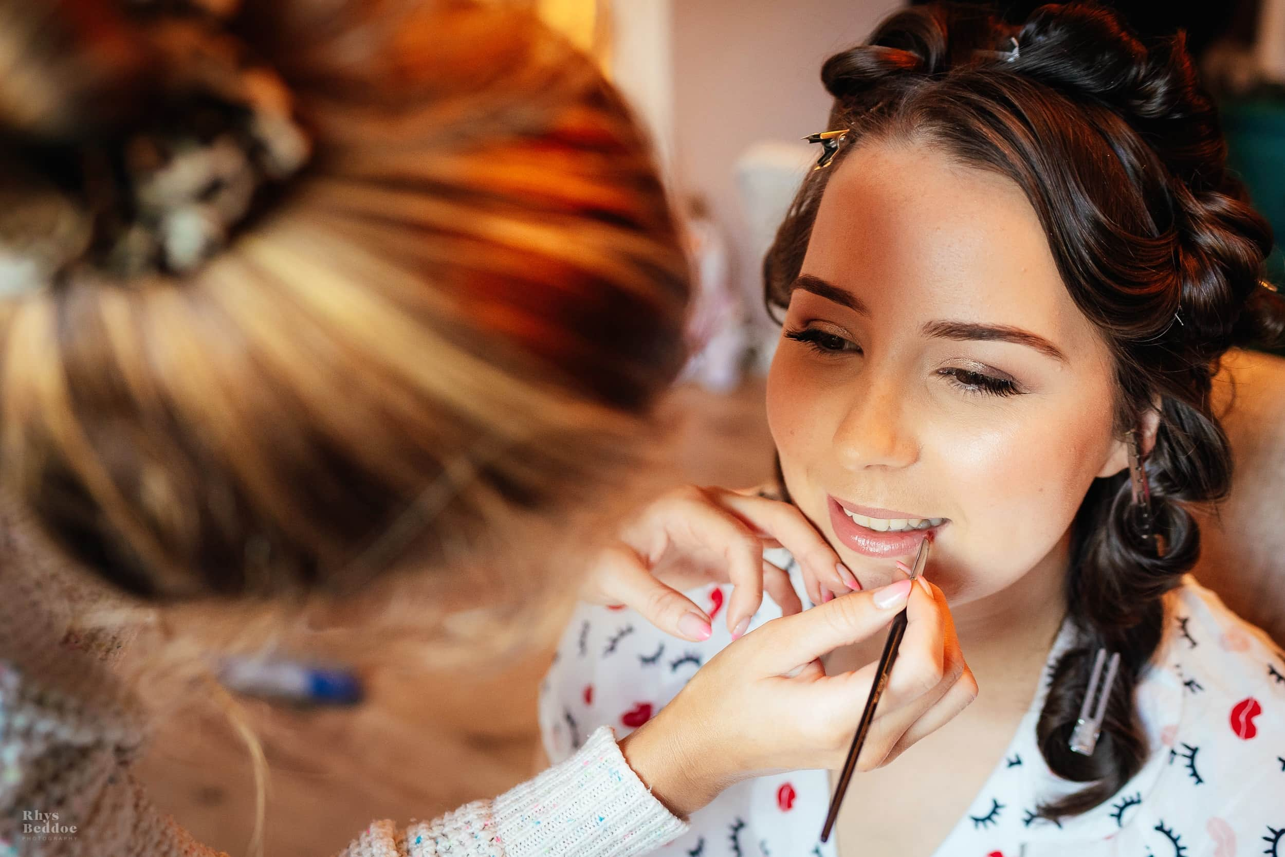 Bride getting her make up done before getting