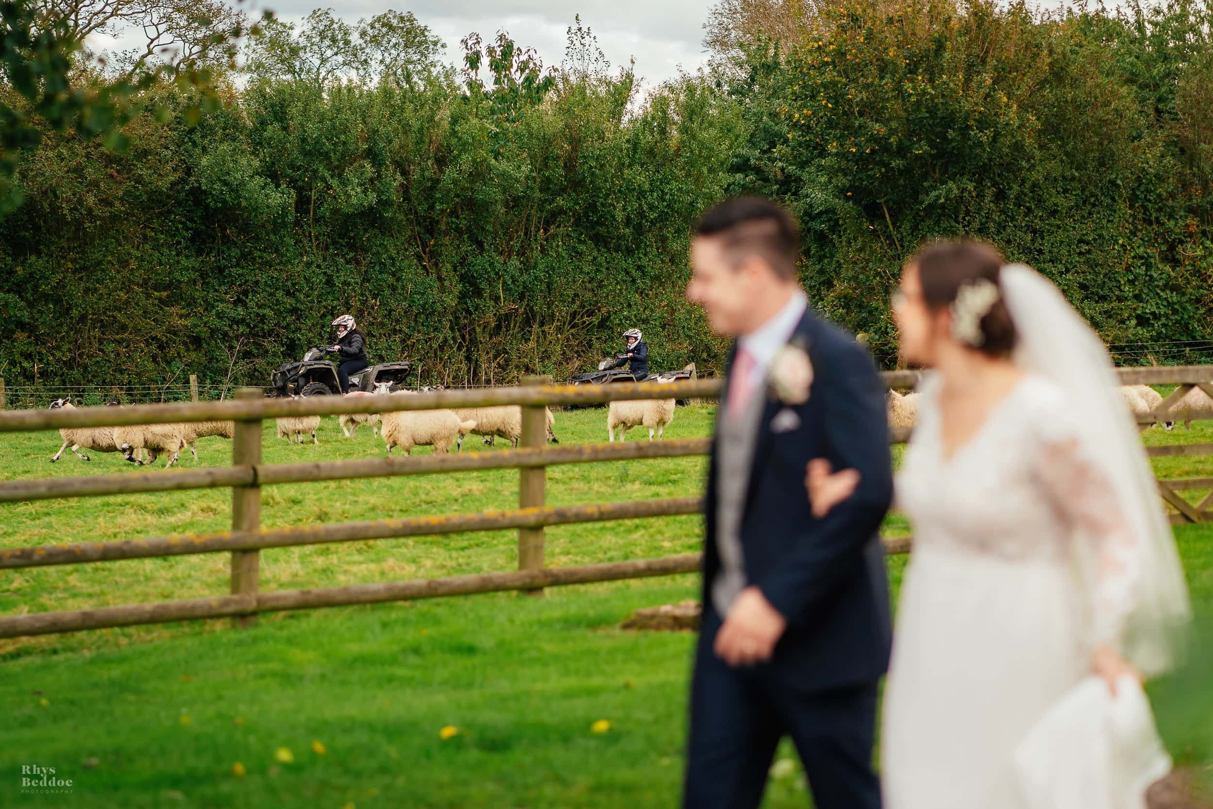 Couple walking and talking after getting married at mythe barn
