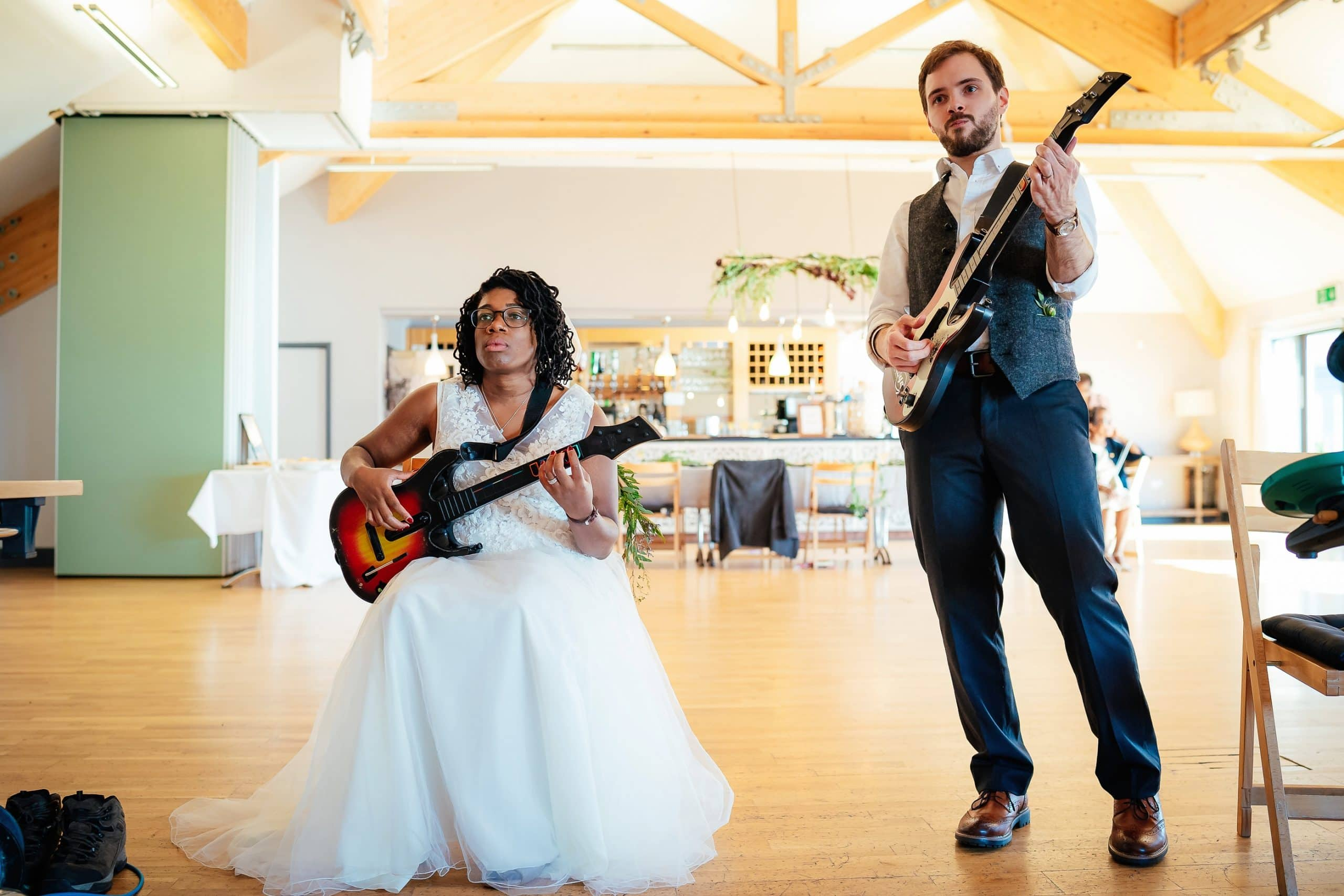 Playing guitar hero on their wedding day