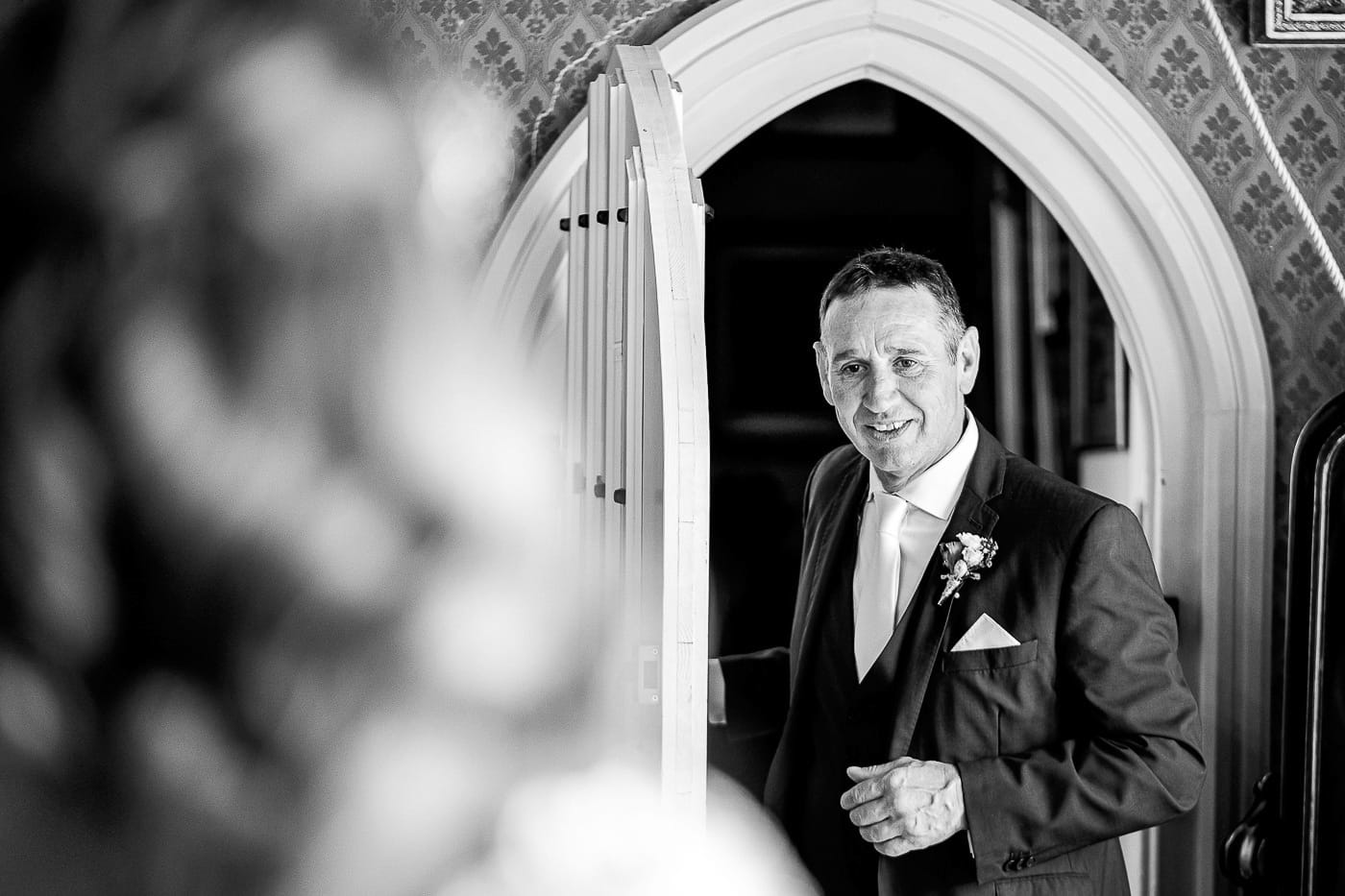 father of the bride seeing his daughter in her wedding dress for the first time at Maunsel House