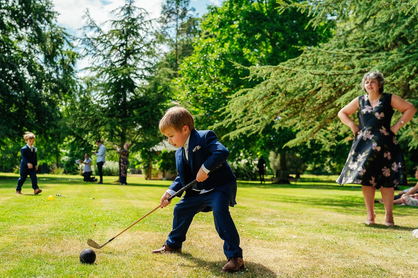 Child playing golf at wedding