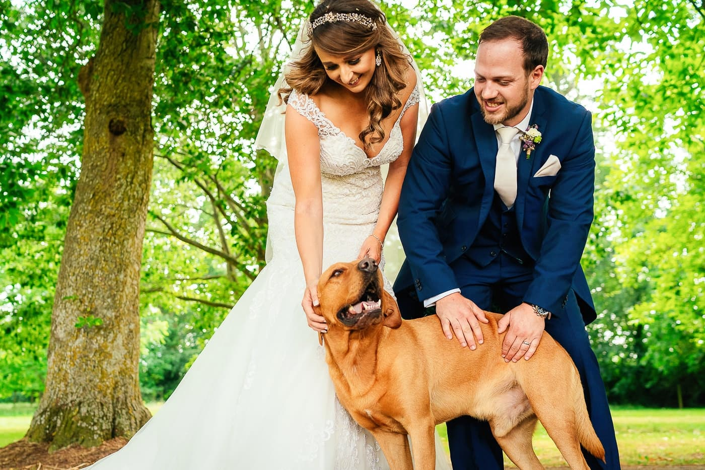 bride and groom with their dog